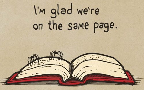 "Two spiders standing on an open book. The caption reads ""I'm glad we're on the same page."""
